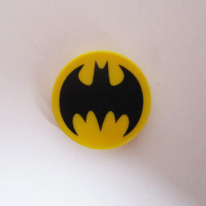 "Circular Tile w/ ""Batman"" Symbol - Yellow & Black"